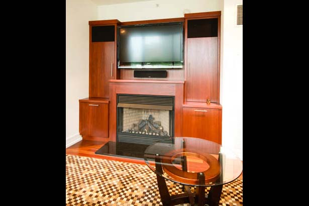 To Accent The Fireplace With Storage And A Flastcreen TV With A Surround  Sound System, This Contemporary Mahogany Built In Was Designed.